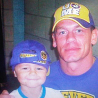 Lewis with his Wrestling hero John Cena